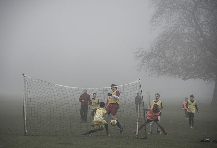 Football on a foggy day at Wandsworth Common, London - image by Brian Cassey